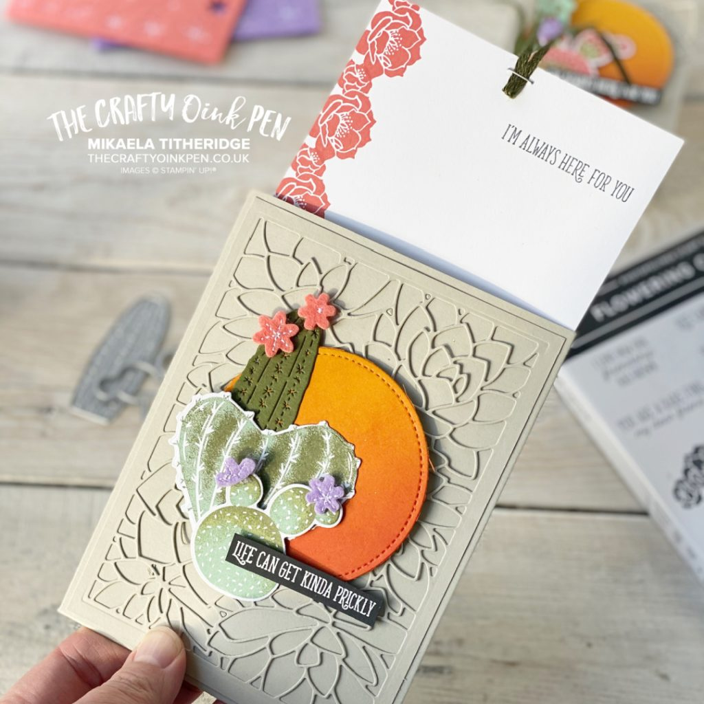 A Flowering Cactus on a glowing sunset to the front of a slider card with succulents die cut images handmade using Stampin' Up! products