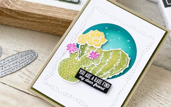 Homemade card with Flowering Cactus plants before a sponged blue sky